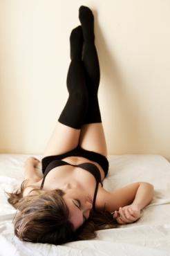 Woman on bed - yoga and sex